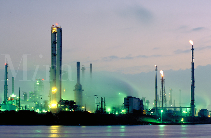Petrochemical plant on Houston ship channel, refinery flares, dawn. Houston Texas.