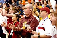 JENNIFER SAVARIO Northwest Arkansas Times<br />Arkansas men's track coach John McDonnell, center, claps along with fans as senior James Hatch runs the Men's 800 Run on Saturday in the NCAA Indoor Championship at Randal Tyson Track Center.