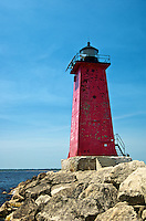 The bright red Manistique East Breakwater Light in beautiful Manistique, MI, Upper Peninsula.
