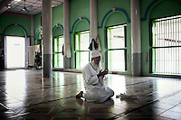 The Imam of Talanburee Mosque, that was attacked by Buddhist nationalists in 1997, prays in Mandalay. /Felix Features