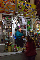 Peru, Cusco, San Pedro Market.  Customer Patronizing a Breakfast and Snack Shop in the Food Court Area of the Market.