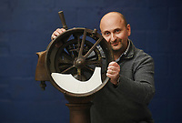 BNPS.co.uk (01202 558833)<br /> Pic: ZacharyCulpin/BNPS<br /> <br /> Auctioneer Andrew Aldridge pictured with the salvaged telegraph which sold for £94,000 at auction<br /> <br /> Relics salvaged from the sunken ship that rescued the Titanic survivors have sold at auction for £135,000.<br /> <br /> The rare items included the engine room order telegraph the captain of the Carpathia used after he received the SOS from Titanic.<br /> <br /> He moved the handle to 'Full Steam Ahead', instructing staff in the engine room to rapidly increase speed