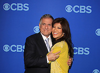 Julie Chen (The Talk and Big Brother) and Leslie Moonves (President and Chief Executive Officer, CBS Corporation) and wife and husband at the CBS Upfront 2013 on May 15, 2013 at Lincoln Center, New York City, New York. (Photo by Sue Coflin/Max Photos)