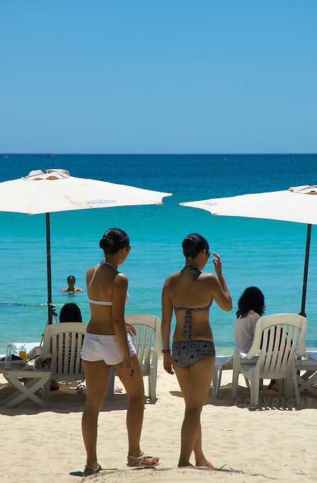 Girls walking at the famous white beach on BORACAY ISLAND PHILIPPINES