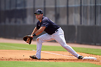 FCL Yankees first baseman Alex Guerrero (63) stretches for a throw during a game against the FCL Blue Jays on June 29, 2021 at the Yankees Minor League Complex in Tampa, Florida.  (Mike Janes/Four Seam Images)