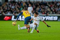 Sunday 9th November 2014<br /> Pictured: ( L-R )  Alex Oxlade-Chamberlain of Arsenal is tackles by Jefferson Montero of Swansea City<br /> Re: Barclays Premier League Swansea City v Arsenal at the Liberty Stadium, Swansea, Wales,UK