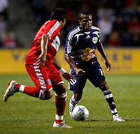New York midfielder Dane Richards (19) takes on Chicago Fire midfielder Diego Gutierrez (8).  The Chicago Fire defeated the New York Red Bulls 1-0 at Toyota Park in Bridgeview, IL on September 6, 2008.