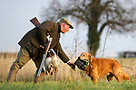 Pix: Shaun Flannery/sf-pictures.com..COPYRIGHT PICTURE>>SHAUN FLANNERY>01302-570814>>07778315553>>..19th December 2008...............Loversall 'game shoot' in Doncaster, South Yorkshire..A gun and his Golden Retriever 'bag' Duck after a drive.