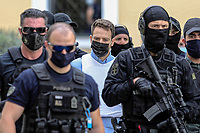 Pictured: Charalambos (Babis) Anagnostopoulos being led to a magistrate guarded by police in Athens, Greece. Tuesday 22 June 2021<br /> Re: Charalambos (Babis) Anagnostopoulos, the husband of Caroline Crouch, who was killed in front of her 11 month old daughter is due to appear before a Magistrate, after being charged with her murder at their home in Glyka Nera, near Athens, Greece.<br /> The woman, 20, was allegedly first tortured and then strangled to death.