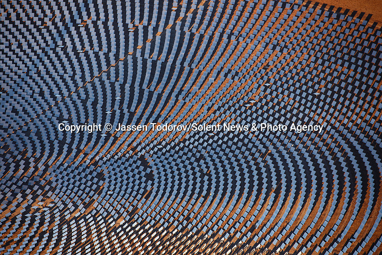 Pictured: A birds-eye views of a solar farm as it creates a sci-fi landscapes covering thousands of acres, USA. <br /> <br /> Amazing aerial photos show off the majesty of America's landscape, its architecture, its industry and its wildlife.   From the startling blue potash pools of Utah to hundreds of aircraft sitting unused due to the pandemic, the images display a little seen side of the USA.<br /> <br /> Other images include a passenger plane plane as it touches down in California taken 4,500ft above it, fog over the Golden Gate Bridge and a solar farm in Nevada.   Professor of Music Jassen Todorov, from San Francisco, captured the striking pictures of the American West while flying in a light aircraft.   SEE OUR COPY FOR DETAILS<br /> <br /> Please byline: Jassen Todorov/Solent News<br /> <br /> © Jassen Todorov/Solent News & Photo Agency<br /> UK +44 (0) 2380 458800