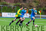 Brandon Hoare of Castlegregory tries to get past Alan Quirke and Luke Bradley of Strand Road in the Denny League in Mounthawk Park on Sunday.