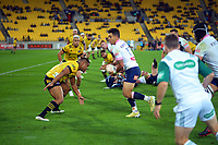 Julian Savea tackles Matt Toomua during the Super Rugby Tran-Tasman match between the Hurricanes and Rebels at Sky Stadium in Wellington, New Zealand on Friday, 21 May 2020. Photo: Dave Lintott / lintottphoto.co.nz