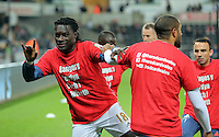 """(L-R) Bafetimbi Gomis and Ashley Williams of Swansea warm up wearing a """"Show Racism A Red Card"""" before the Barclays Premier League match between Swansea City and Stoke City played at the Liberty Stadium, Swansea on October 19th 2015"""