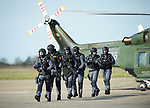 Heavily armed Garda personnel arrive by helicopter during a bilateral training exercise between An Garda Siochana and the Defence Forces hosted at Shannon Airport. Photograph by John Kelly.