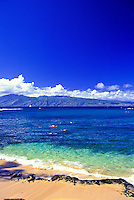 Kapalua Bay with Molokai in backround on a clear day with people snorkling