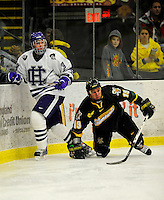29 December 2007: Holy Cross Crusaders' defenseman Matt Celin, a Freshman from Gibsonia, PA, in action against the University of Vermont Catamounts at Gutterson Fieldhouse in Burlington, Vermont. The Catamounts rallied in the final seconds of play to tie the game 1-1. After overtime, although the official result remained a tie game, the Cats moved up to the championship round by winning a sudden death shootout in the second game of the Sheraton/TD Banknorth Catamount Cup Tournament...Mandatory Photo Credit: Ed Wolfstein Photo