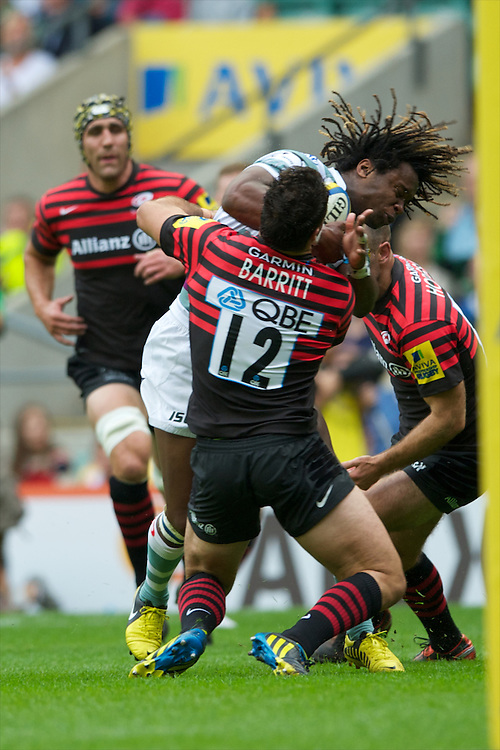 Marland Yarde of London Irish is tackled just short of the line during the Aviva Premiership match between Saracens and London Irish at Twickenham on Saturday 1st September 2012 (Photo by Rob Munro)