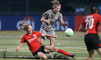 Atlanta midfielder, Amanda Cinalli (15), slide tackles the ball away from Philly defender, Nikki Krzysik (15).  Atlanta and Philadelphia played to a 0-0 draw in the season opener for both teams at John A Farrell Stadium in West Chester, PA.