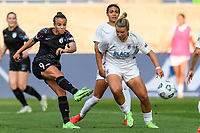 BRIDGEVIEW, IL - JULY 18: Mallory Pugh #9 of the Chicago Red Stars shoots the ball during a game between OL Reign and Chicago Red Stars at SeatGeek Stadium on July 18, 2021 in Bridgeview, Illinois.