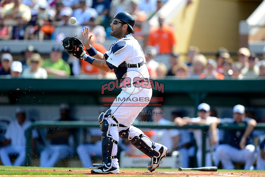 Detroit Tigers catcher Alex Avila #13 catches a pop up during a Spring Training game against the Atlanta Braves at Joker Marchant Stadium on February 27, 2013 in Lakeland, Florida.  Atlanta defeated Detroit 5-3.  (Mike Janes/Four Seam Images)