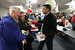 Tom and Lee Johnson talk with Gov. Brian Sandoval while waiting for the Republican caucus to begin at Caughlin Ranch Elementary School in Reno, Nev. on Tuesday, Feb. 23, 2016. Cathleen Allison/Las Vegas Review-Journal
