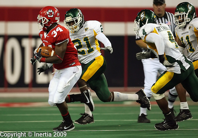 VERMILLION, SD - SEPTEMBER 26: Isaac Newton #34 of the University of South Dakota tries to get past Re'Keem Wilson #21 of Southeastern Louisiana during the third quarter of their game Saturday evening at the DakotaDome in Vermillion. (Photo by Dave Eggen/Inertia)