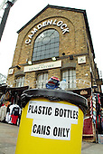 Recycling bin for cans and plastic bottles, Camden Lock Market, Camden Town, London.