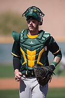 Oakland Athletics catcher Jonah Heim (55) during a Minor League Spring Training game against the Chicago Cubs at Sloan Park on March 19, 2018 in Mesa, Arizona. (Zachary Lucy/Four Seam Images)