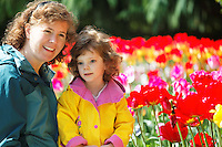 Mother and child in multi-colored tulip field, Skagit Valley, Mount Vernon, Washington, USA