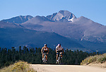 Young couple biking along path below Longs Peak, Rocky Mtn Nat'l Park, CO
