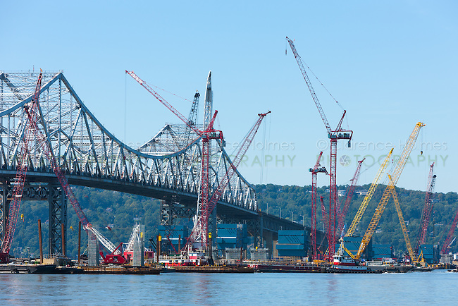 Barge mounted cranes work on construction of the New Tappan Zee Bridge adjacent to the existing bridge over the Hudson River between Westchester and Rockland counties.