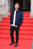 "Jeremy Irvine<br /> arriving for the premiere of ""The Wife"" at Somerset House, London<br /> <br /> ©Ash Knotek  D3418  09/08/2018"