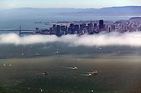 aerial photograoh sailboat racing San Francisco bay San Francisco skyline and bay bridge in background