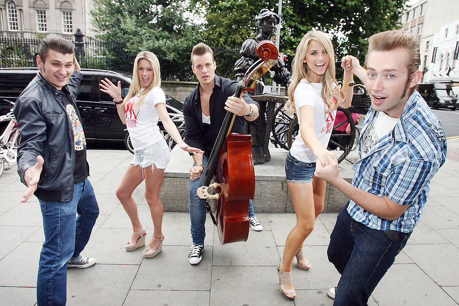 """NO REPRO FEE. 29/7/2010. Everybody's favourite German Rock 'n' Roll band, THE BASEBALLSare pictured on Grafton St Dublin for their first Irish visit to promote their massive hit album 'Strike'. The trio of Sam, Digger and Basti  are pictured with models Jenny Lee Masterson and Vogue Williams. The band represent a new evolution of the musical heritage of Elvis, Jerry Lee Lewis, Buddy Holly & Co. - """"Voc'n'Roll"""" was born and The Baseballs at the same time!<br /> The bandput a truly unique twist on modern day anthems such as Rihanna's 'Umbrella', Beyonce's 'Crazy in Love', and new single, theirtake on Katy Perry's 'Hot n Cold'.To quote the band, """"We take good songs and lead them to their true calling.""""Already massive all over Europe, their debutalbum has sold over 600,000 albums worldwide so far and debuted at No.4 in the UK.T The Baseballssupport Jeff Beck on his UK tour in October -including a date at the Royal Albert Hall - and aredue to return to Irelandlater this year for their debut Irish show.Official site: www.thebaseballs.com Photos: www.thebaseballs.com/photos Videos: www.thebaseballs.com/videos For more info please contact: Ciaran Savage, Warner Music Ireland - Tel: 086 8747 704 John McCallion, Warner Music Ireland - Tel: 087 7679 554. Picture James Horan/Collins Photos"""