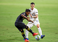 CARSON, CA - SEPTEMBER 06: Latif Blessing #7 of LAFC moves with the ball past Cristian Pavon #10 of the Los Angeles Galaxy during a game between Los Angeles FC and Los Angeles Galaxy at Dignity Health Sports Park on September 06, 2020 in Carson, California.
