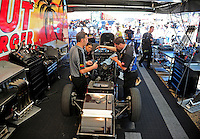 May 22, 2011; Topeka, KS, USA: Crew members work on the car of NHRA funny car driver Melanie Troxel (not pictured) during the Summer Nationals at Heartland Park Topeka. Mandatory Credit: Mark J. Rebilas-