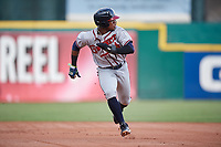 Gwinnett Braves left fielder Ronald Acuna (24) runs back to first after a fly out during a game against the Buffalo Bisons on August 19, 2017 at Coca-Cola Field in Buffalo, New York.  Gwinnett defeated Buffalo 1-0.  (Mike Janes/Four Seam Images)