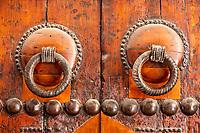 Fes, Morocco.  Door Knockers on a Door of the Kairaouine Mosque, Fes El-Bali.