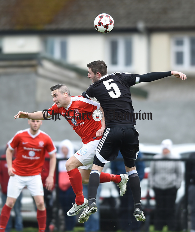 Eoin Hayes of Newmarket Celtic in action against Aidan Hurley of Janesboro during their Munster Junior Cup semi-final at Limerick. Photograph by John Kelly.