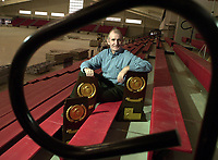 Arkansas Democrat-Gazette/CINDY BLANCHARD<br /><br />Universsity of Arkansas mens head track and field coach John McDonnell in the new indoor track.<br />01/26/00