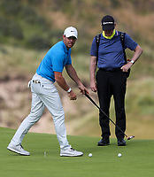 160719 | The 148th Open - Tuesday Practice<br /> <br /> Rory Mcilroy and coach Michael Bannon on the 15th green during practice for the 148th Open Championship at Royal Portrush Golf Club, County Antrim, Northern Ireland. Photo by John Dickson - DICKSONDIGITAL