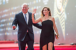 Mark O'Meara of USA and his wife walk the Red Carpet event at the World Celebrity Pro-Am 2016 Mission Hills China Golf Tournament on 20 October 2016, in Haikou, China. Photo by Weixiang Lim / Power Sport Images