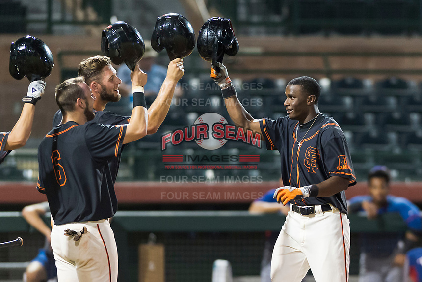 AZL Giants Black left fielder Kwan Adkins (8) is congratulated by Cody Brickhouse (6) and Zander Clarke (9) after hitting a home run during an Arizona League game against the AZL Rangers at Scottsdale Stadium on August 4, 2018 in Scottsdale, Arizona. The AZL Giants Black defeated the AZL Rangers by a score of 6-3 in the second game of a doubleheader. (Zachary Lucy/Four Seam Images)