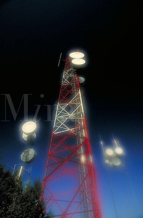 Antennae, on high forested hilltop. Antenna, communications, electronics high technology, radio, color, mist, industry. Parksville British Columbia Canada Vancouver Island.