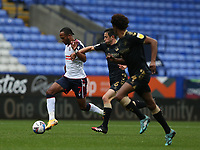 Bolton Wanderers' Nathan Delfouneso shields the ball from Oldham Athletic's Ben Garrity<br /> <br /> Photographer Stephen White/CameraSport<br /> <br /> The EFL Sky Bet League Two - Bolton Wanderers v Oldham Athletic - Saturday 17th October 2020 - University of Bolton Stadium - Bolton<br /> <br /> World Copyright © 2020 CameraSport. All rights reserved. 43 Linden Ave. Countesthorpe. Leicester. England. LE8 5PG - Tel: +44 (0) 116 277 4147 - admin@camerasport.com - www.camerasport.com