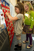 MR / Schenectady, NY. Zoller Elementary School (urban public school). Kindergarten inclusion classroom. Students (girls, 5) selecting activity for learning center time. MR: Cas12, Deg9. ID: AM-gKw. © Ellen B. Senisi.