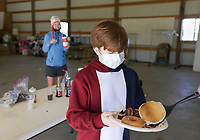 "Volunteer Darren Hillis (not pictured) serves food to Jacob Rogers, 12, of Rogers, Sunday, November 15, 2020 at Central United Methodist Church in Rogers. The Church hosted their Breakfast of Champions free breakfast distribution, which is part of their 11th annual Turkey Bowl. Central United Methodist and First United held a student-led competition to raise food for the Grace food pantry. The event also included a bowling night. Last year, they collected 3,200 items for the Grace food pantry. ""Grace in November and December sees a huge increase in need,"" said Lucy Swanson, director of youth ministries. ""The purpose is to help Grace survive November and December."" Check out nwaonline.com/201116Daily/ for today's photo gallery. <br /> (NWA Democrat-Gazette/Charlie Kaijo)"