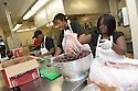 Liberty Kitchen trainees Kierstin Mitchell, Charles Williams, Jory Adams and Kearrol Bridges prepare lunch for students at the New Orleans College Prop School in New Orleans, Thurs., March 22, 2012.