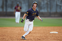 Dustin Baber (9) of the North Carolina A&T Aggies hustles towards third base against the North Carolina Central Eagles at Durham Athletic Park on April 10, 2021 in Durham, North Carolina. (Brian Westerholt/Four Seam Images)