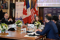 Canadian Foreign Minister Chrystia Freeland hosts the G-7 Foreign Ministers' Working Session on the Middle East, in Toronto, Canada, April 22, 2018. French Minister of Europe and Foreign Affairs Jean-Yves Le Drian is seated next to her.